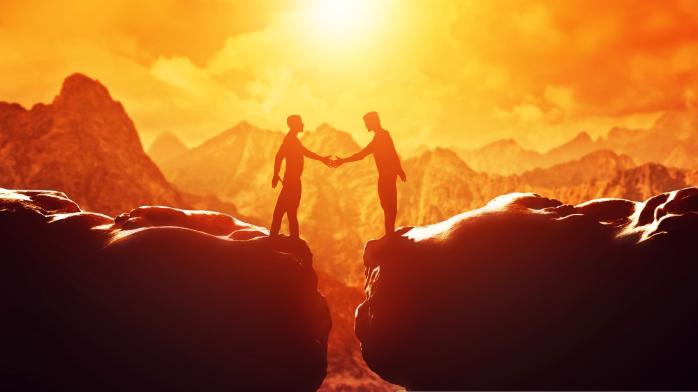 Two men shake hands over precipice. Business, handshake, deal.